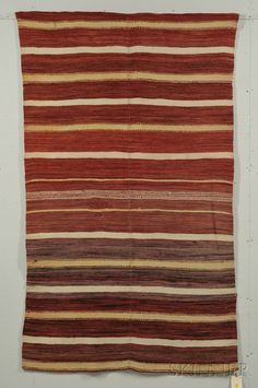 Rio grande weaving c last quarter century woven in two panels with white and light yellow stripes on a variegated red ground 78 12 x 46 12 in Native American Rugs, Indian Blankets, Navajo Rugs, Upholstered Ottoman, Striped Rug, Yellow Stripes, Rio Grande, First Nations, Stripes Design