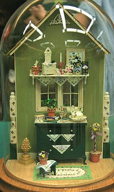 Vignettes and Miniature Windowbox Displays From the Fall 2010 Seattle Show: A pansy themed vignette featuring a dolls house scale dresser and shelf by Janey Elliot, exhibited at the fall 2010 Seattle Dollhouse Miniature show.