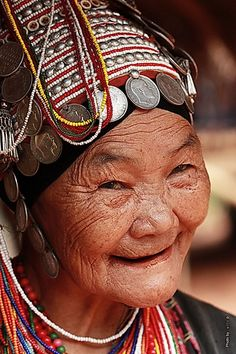 Akha Woman. Chiang Rai, Thailand. George had his picture taken with a women who looked very similar to this beautiful woman.  Sweet people!