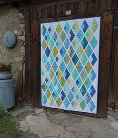 """Pattern """"Boomerang"""" by Jaybird Quilts, modified using additional white background stripes."""