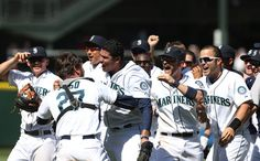 Starting pitcher Felix Hernandez #34 of the Seattle Mariners gets a hug from catcher John Jaso #27 after throwing a perfect game against the Tampa Bay Rays at Safeco Field on August 15, 2012 in Seattle, Washington.