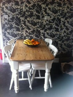 Crisp white Farmhouse Table & Chairs with loads of life ahead of itself now its been upcycled