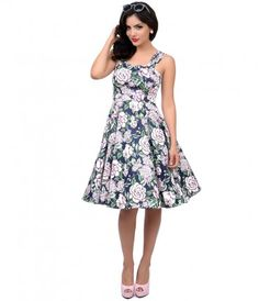 Wave hello to a botanical beauty! A charming navy blue and soft pink floral vintage style dress boasting a dainty pleate...Price - $68.00-sdrHBBTJ