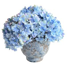 Lovely on its own or anchoring an organic-chic vignette, this classic faux hydrangea arrangement is nestled in a glazed terracotta pot.