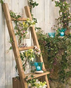 flower jars hung from ladder rungs.
