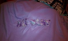 No sew.  Used two coordinating fleece blankets and tied ends together.  Applique lettering with felt from hobby lobby.  The lettering outline is fabric paint.