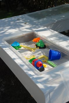 Outdoor sand and play tables made out of storage bins. @Meghan Amos, I remember you saying this is similar to what you did! lol Ghetto sandbox was it?