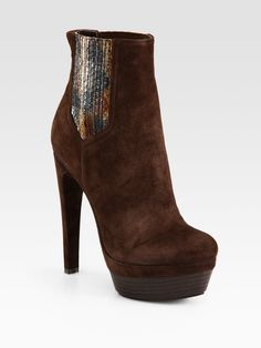 Brown high heel booties with snake print embellishment!