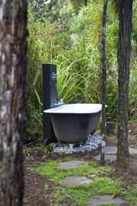 The outdoor bathtub is fully functioning and another example of the back-to-nature aspect of the project. #outdoorliving