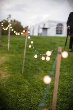 Easy and adorable to mark the 3 sides of the wedding area, instead of the Edison bulbs which would give off as much light