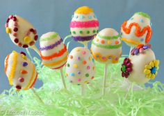 Make your Easter sweeter with these Easter Egg Cake Pops! Moist bites of cake and frosting are formed into egg shapes, made into lollipops, and decorated to look like festive Easter eggs. Don't miss the tutorial with step-by-step photos showing how to make Easter egg cake pops!