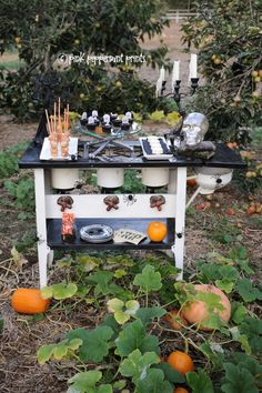 Styled Shoot: Pottery Barn Halloween Party: Bone Appetit Dessert Table Styled Shoot: Pottery Barn Halloween Party: Bone Appetit Dessert Table » Pink Peppermint Prints and Parties dessert table set up DIY white chocolate skulls, pumpkin patch, #potterybarn #Halloween