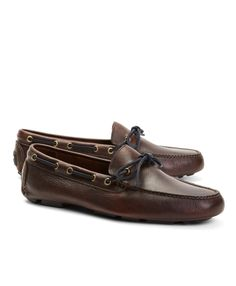 Driving mocs, made from pebble leather. Rubber sole. Suede laces. Tone-on-tone stitching. Imported.