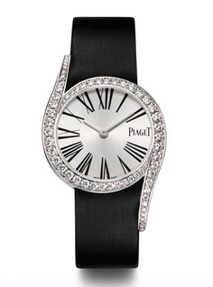 The @Piaget Limelight Gala, with white gold case set with 62 brilliant-cut diamonds. Silvered dial with black Roman numerals, black satin strap, and ardillon buckle set with one brilliant-cut diamond. It utilises a Piaget 690P quartz movement.