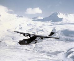 PBY-5A Catalina aircraft of US Navy Patrol Squadron VP-61 in flight in the Aleutian Islands, US Territory of Alaska, Mar 1943