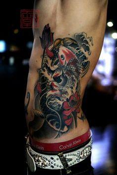 Awesome Koi Fish Rib Tattoo