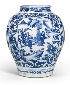 A BLUE AND WHITE JAR MING DYNASTY, WANLI PERIOD robustly potted, with the ovoid body rising to a waisted neck with lipped rim, the exterior painted in bright tones of cobalt-blue with four oval cartouches enclosing figures amongst landscapes, all reserved on floral blooms borne on meandering leafy scrolls, the neck and the foot encircled by stylised floral sprays H. 40cm
