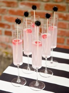 Keep things classy on Oscar night with these pom pom swizzle sticks.