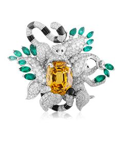 Makis clip, Les Voyages Extraordinaires™ collection, Van Cleef & Arpels  White gold, cushion-cut yellow sapphire, emeralds, diamonds