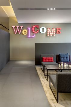 "Read More""russia 2015 - azimut - international chain - living lobby - golden - reception - modern - vintage carpet - chair - neon letter - colors - Creative Office Space, Office Space Design, Office Interior Design, Office Interiors, Office Reception, Reception Areas, Industrial Office Space, Industrial Lighting, Modern Lighting"