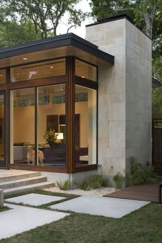 KW to MA: Corner treatment with wood. modern architecture - brian dillard architecture - dry creek house - austin - texas - exterior view: