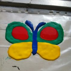 Colorful butterfly made with kids painting