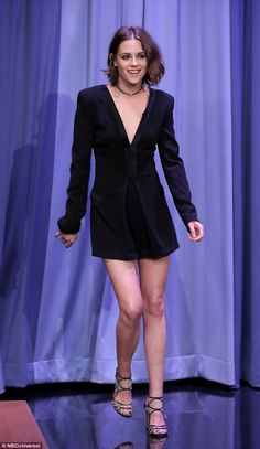 All dressed up: Kristen Stewart ditched her tomboy look for a more feminine velour dress t...