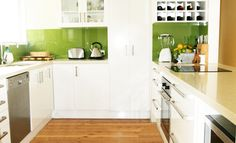 Love lime green splashbacks! Don't know that I'd be game enough to do it? | Bexley | Kitchen By: House of Kitchens |