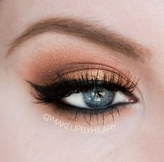 Mac Paint Pot in Painterly. Mac Eyeshadow in Amber Lights and Nylon. MG Eyeshadows in Cocoa Bear, Corrupt, Peach Smoothie and Vanilla Bean. Laura Geller Eye Calligraphy Liquid Liner and Urban Decay Black Velvet Eyeliner