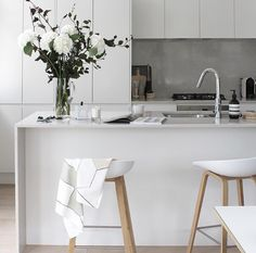 Grey scale kitchen | Modern | White Stone bench top | Concrete accents