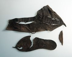 Leather shoe from Bryggen in Bergen, Norway. This shoe, designated B605 for it's runic inscription, was originally embroidered over the incisions made in the leather. The runes that run along the vamp say  ...am(or)u-iciþomnia..., which has been normalised to amor vincit omnia (love conquers all). Dated circa 1180-1190. Museum : Universitetsmuseet i Bergen.  MuseumNo : BRM_0/052927.  InventoryNo : DpA_000170. For more information see: http://medieval-baltic.us/vikrune.html