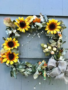 A personal favorite from my Etsy shop https://www.etsy.com/listing/526614236/fall-wreath-sunflower-wreath-front-door