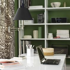 Gorgeous home office and great Feng Shui! I love the rich green walls with high contrast white shelving + those fabulous draperies! Free of clutter for your clear + focused mind.