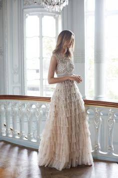 The layers of frothy tulle, sequins, + allover beaded embellishments on this wedding dress will speak to your inner Disney princess.