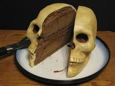 I've seen this before online and the sculpture of the cake design is brilliant. I thought before that the icing between the layers could be dark red, too...like oxidized blood.