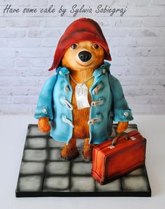 Hello! Who is the best friend every child? The Bear i think ;) Please meet the Paddington bear . All edible, chocolate mud cake filled with mascarpone cream and raspberry mousse and dark chocolate ganache. I had a great fun making him.