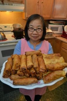 Champy Bouttavong's Laotian Egg Rolls. Learn how to prepare similar traditional meals on a Laotian Cooking class from Viator. Find out more at: http://www.allaboutcuisines.com/cooking-school-classes/laos/in/laos #Laotian Food #Laotian Cooking Classes. #Cooking Schools Laos