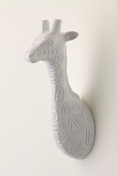 I wonder if you could make this by cutting a cheap toy (dollar section at target) and spray painting it?