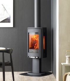 Learn more about the Jotul Wood Stove among the fireplace products at Hearth and Home Calgary. Modern Log Burners, Modern Wood Burning Stoves, Wood Stoves, Corner Log Burner, Wood Burning Stove Corner, Wood Burner Fireplace, Fireplace Hearth, Gas Fireplaces, Fireplace Stores