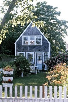 cedar shake sided cottage- and that white chair on the front-is where i am going to read my favorite novels :)