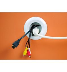 Legrand's Flat Screen TV Cord and Cable Power Kit is designed to hide wires from your cable box (and other equipment) up to your wall-mounted television. The gaskets through which the cables run include outlets for your gear so it doesn't have to stand so far off the wall!