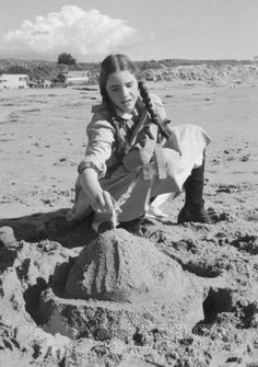 Melissa, are you trying to make a sand castle? :P