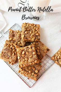 A homemade, pantry staples recipe. Chewy, peanut buttery goodness–these brownies feature a subtle swirl of hazelnut spread and extra peanut butter chips on top for good measure. They are a spin off of our popular, original Best Peanut Butter Brownie recipe. #nutella #brownies #peanutbutter #pantrystaples