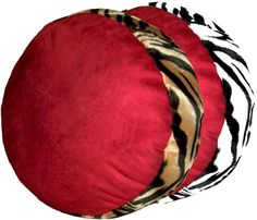 "Zebra Animals Bordering Africa Round Pillow  Incredible !  Luxurious Cranberry Red Bordering Africa Pillow.  Base is Cranberry Red Faux Suede, with an animal print Faux Fur Border. Great alone, or mix with another shape, or a plain pillow, even another Faux Fur pillow.  Poly fiber Pillow Insert, with a none-removable Cover. Damp Cloth Clean.     Round: 18"" diameter Rectangle: 13"" x 20""   Square: 19"" x 19"" Triangle: 17"" x 17"" x 25""   $59.00"