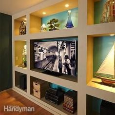 Construct a dramatic built-in bookcase and entertainment center with these simple plans. All you need is some inexpensive lumber and drywall.: