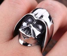 The Dark side has never looked as fashionable as it does with the Darth Vader ring. Not even the Dark Lord's flowing black robes can match the beauty and craftsmanship of this hand made sterling silver ring. It's a perfect fit for any Star Wars fan.