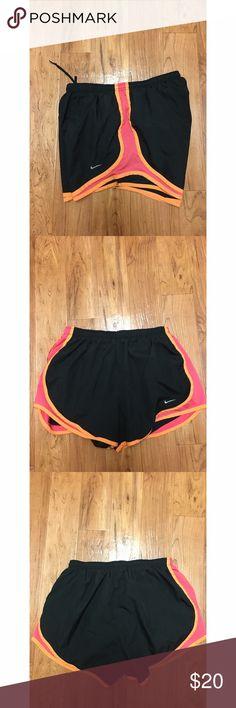 Nike dri Fit running shorts Omens side medium Nike dri Fit running shorts. Worn one time. No flaws. Very comfortable! Nike Shorts