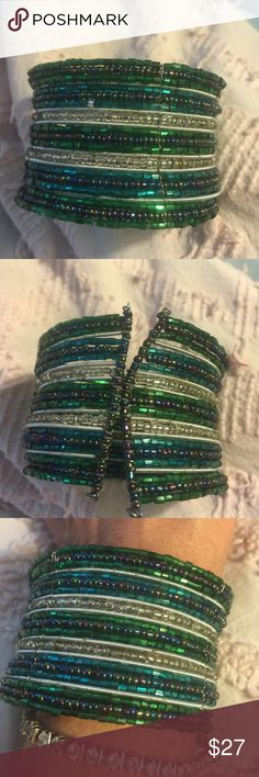 ✨Authentic Vintage 1960's cuff wire bracelet✨ ✨✨Authentic Vintage 1960's wire cuff bracelet. Purchased at antique shop in Northern California. Beautiful sparkling wire with silver, purple, green & teal colors. An amazing vintage cuff. You won't see this on anyone else ✨✨✨✨ absolutely gorgeous Jewelry Bracelets