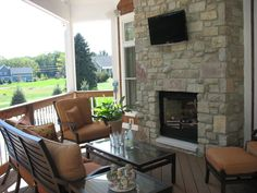 Porch opposite hearth room. They share fireplace wall.  I want it a bit larger for small eating table, and screened.
