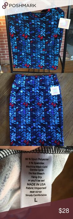 Lularoe Cassie Pencil skirt BNWT Lularoe Cassie skirt...stretchy fabric...multi shades of blue with black and red LuLaRoe Skirts Pencil